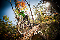 Riders tackle a challenging section of elevated trail in Copper Harbor Michigan Michigan's Upper Peninsula.