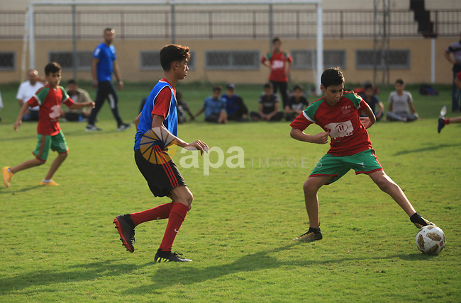 """Palestinian players compete in a match of the """"Malaysian-Palestinian Football league"""", Organizer by the Ministry of sport and youth, in Gaza city on September 19, 2019. Photo by Mahmoud Ajjour"""