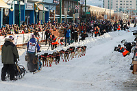 Shaynee Traska leaves the 4th avenue start line during the ceremonial start of the 2019 Iditarod in downtown Anchorage, Alaska on Saturday March 2.<br /> <br /> Photo by Jeff Schultz/  (C) 2019  ALL RIGHTS RESERVED