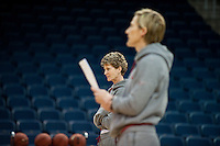 NORFOLK, VA--Assistant Coach Amy Tucker watches formations during an off-day practice session at the Ted Constant Convocation Center at Old Dominion University in Norfolk, VA in the 2012 NCAA Championships. The Cardinal will play West Virginia on Monday, March 19 to qualify for the West Regionals in Fresno.