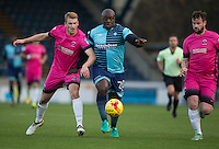 Adebayo Akinfenwa of Wycombe Wanderers battles Scott Harrison of Hartlepool United during the Sky Bet League 2 match between Wycombe Wanderers and Hartlepool United at Adams Park, High Wycombe, England on 26 November 2016. Photo by Andy Rowland / PRiME Media Images.