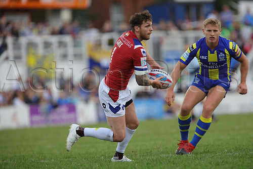 July 1st 2017, Beaumont Legal Stadium, Wakefield, England; The Betfred Super Leauge; Wakefield Trinity versus Warrington Wolves; Scott Grix of Wakefield Trinity passes the ball before cover