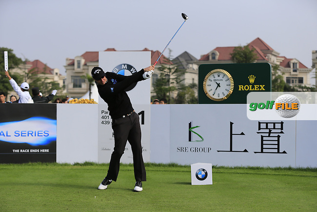Nicolas Colsaerts (BEL) tees off the 1st tee to start his match during Sunday's Final Round of the 2014 BMW Masters held at Lake Malaren, Shanghai, China. 2nd November 2014.<br /> Picture: Eoin Clarke www.golffile.ie