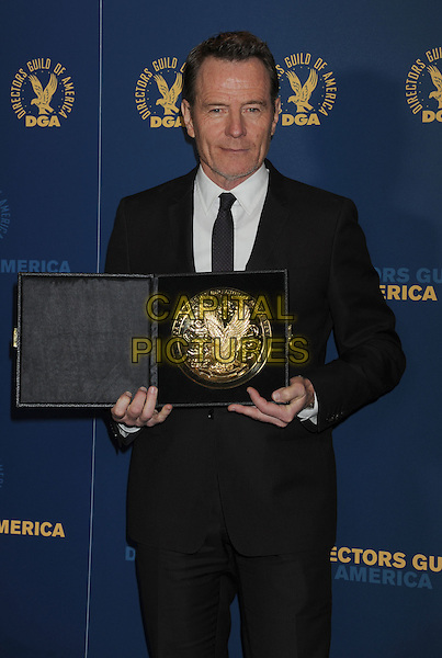 Bryan Cranston.64th Annual Directors Guild Of America Awards held at the Hollywood and Highland Ballroom, Hollywood, California, USA..January 28th, 2012.half length black suit award trophy winner  .CAP/ROT/TM.©Tony Michaels/Roth Stock/Capital Pictures