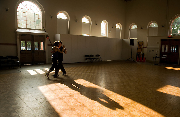 UNITED STATES - JULY 21:  Michael McElroy of Adams Morgan dances the tango with an instructor from New York, during a private lesson in Eastern Market's North Hall.  (Photo By Tom Williams/Roll Call)