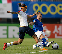 USWNT forward (6) Natasha Kai is tackled by Italy's (5) Viviana Schiavi during the last group stage game at the Peace Queen Cup.  The USWNT defeated Italy, 2-0, at the Suwon Sports Center in Suwon, South Korea.