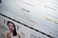 The websites of luxury online retailers Yoox and Net-a-Porter are seen on Tuesday, March 31, 2015. Yoox SpA has agreed to buy Net-a-Porter from Cie. Financier Richmond SA to create the world's largest online luxury goods store. The transaction is all stock and the combination, to be called Yoox Net-a-Porter, will have an estimated annual revenue of 1.3 billion euros. (© Richard B. Levine)