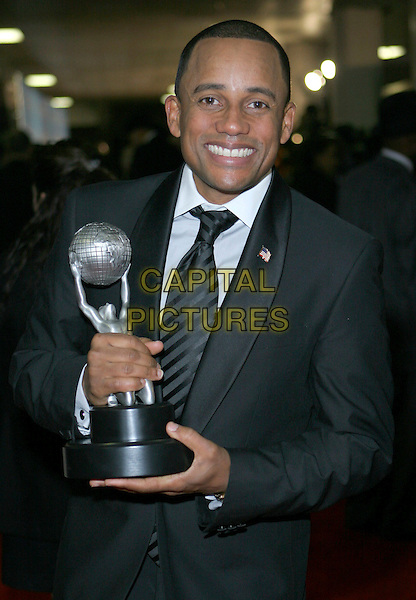 HILL HARPER.40th Annual NAACP Image Awards held at the Shrine Auditorium, Los Angeles, California, USA..February 12th, 2009.half length black suit jacket award trophy .CAP/ADM/TC.©T. Conrad/AdMedia/Capital Pictures.