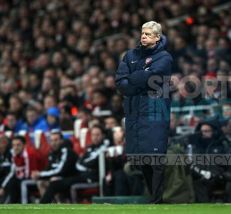 Arsenal's Arsene Wenger looks on dejected<br /> <br /> Arsenal vs Swansea City - Premier League - Emirates Stadium- London - England - 25/03/2014  - Pic David Klein/Sportimage
