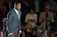 Canton, Ohio - August 1, 2014: Former Defensive End Michael Strahan is introduced to the audience before accepting his gold jacket during the Pro Football Hall of Fame's class of 2014 enshrinement dinner in Canton, Ohio  August 1, 2014. Strahan had 22.5 sacks in a single season (2001) and lead the NFL in sacks in 2001 and 2003.  (Photo by Don Baxter/Media Images International)