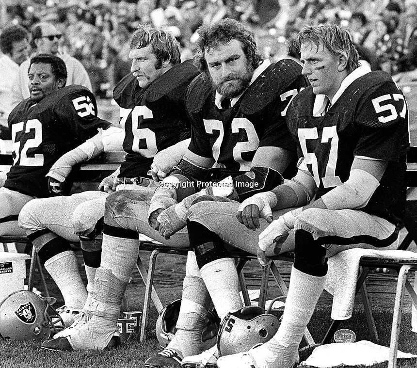 Oakland Raider bence defensive players, #52 Floyd Rice, Pat Toomay, Jaoh Matuszak, #57  John Huddleston. (1977 photo/Ron Riesterer)