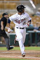 Glendale Desert Dogs outfielder Byron Buxton (15), of the Minnesota Twins organization, runs to first watching a home run during an Arizona Fall League game against the Peoria Javelinas on October 14, 2013 at Camelback Ranch Stadium in Glendale, Arizona.  Glendale defeated Peoria 5-1.  (Mike Janes/Four Seam Images)