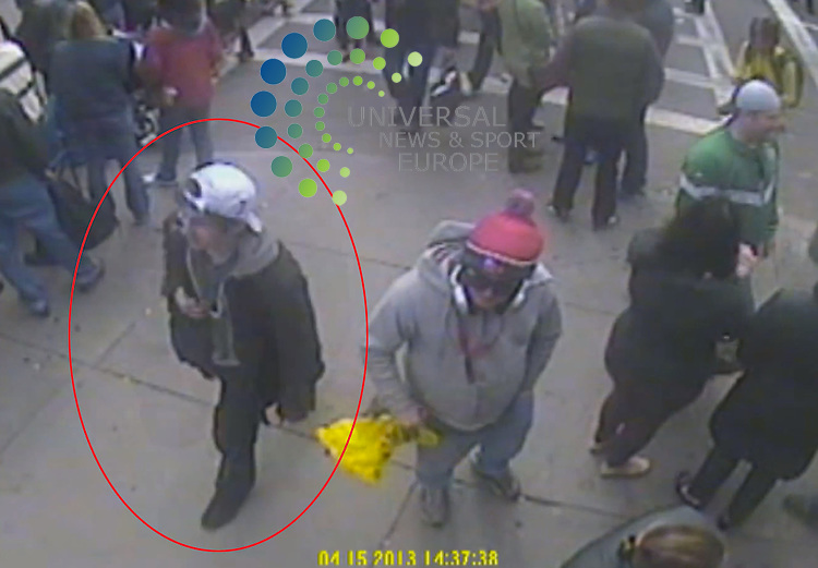 The FBI has released photos of two suspects ringed in red  it wants to identify as part of the investigation into Monday's Boston marathon bombings..CCTV captured the two men, one wearing a dark-coloured baseball cap and the other a white cap, near the scene..FBI Agent Richard DesLauriers warned members of the public not to approach the two men..Picture: FBI/Universal News And Sport (Europe) 18 April 2015.