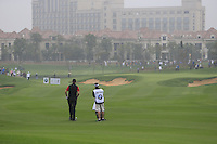 Ross Fisher (ENG) and caddy Mark Sherwood wait on the 5th hole during Saturay's Round 3 of the 2014 BMW Masters held at Lake Malaren, Shanghai, China. 1st November 2014.<br /> Picture: Eoin Clarke www.golffile.ie