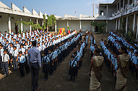 Children from ages 4 to 16 line up during morning assembly in the Vasudha Vidya Vihar school in Khargone, Madhya Pradesh, India on 12 November 2014. This school was built using the Fairtrade Premium funds of the Fairtrade cotton farmers and producers in Karhi village of Khargone. Photo by Suzanne Lee for Fairtrade