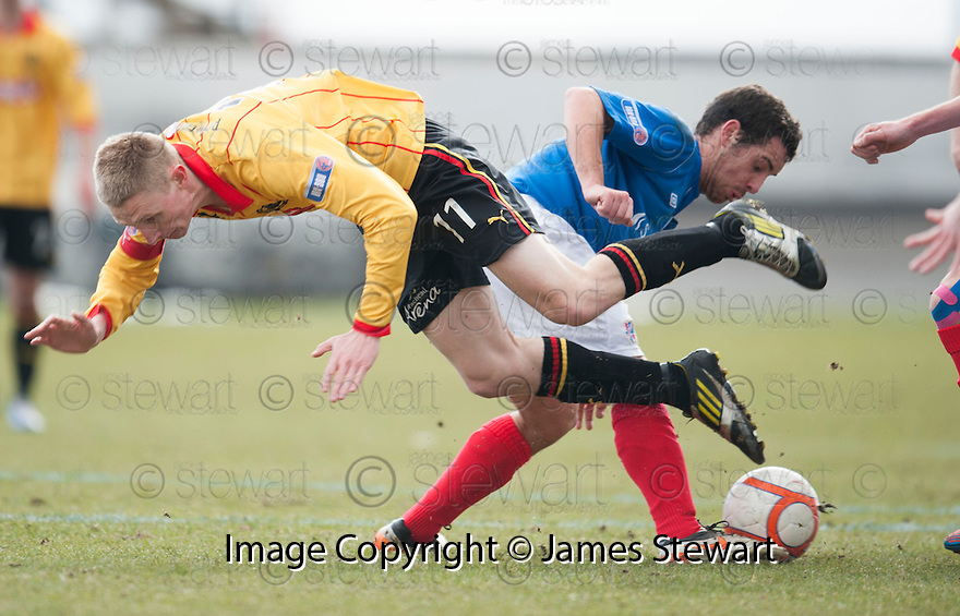 Thistle's Chris Erskine goes over head first.