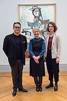 """Die Ausstellung """"Picasso. Das spaete Werk"""" wird vom 9. Maerz bis 16. Juni 2019 im Potsdamer Museum Barberini gezeigt.  Alle Leihgaben, Gemaelde, Keramiken, Skulpturen und Graphiken von Pablo Picasso (1881–1973), stammen aus der Sammlung Jacqueline Picasso (1927–1986).<br /> In der von Gastkurator Bernardo Laniado-Romero getroffenen Auswahl befinden sich zahlreiche Werke, die erstmalig in Deutschland gezeigt werden sowie einige, die zum ersten Mal in einem Museum praesentiert werden.<br /> Im Bild vlnr.: Bernardo Laniado-Romero, Kurator der Ausstellung; Ortrud Westheider, Direktorin, Museum Barberini; Valerie Hortolani, Kuratorische Mitarbeit Museum Barberini vor dem Gemaelde """"Frau mit Hund"""", Oel auf Leinwand, vom Mai 1959 bis Januar 1960.<br /> 7.3.2019, Potsdam<br /> Copyright: Christian-Ditsch.de<br /> [Inhaltsveraendernde Manipulation des Fotos nur nach ausdruecklicher Genehmigung des Fotografen. Vereinbarungen ueber Abtretung von Persoenlichkeitsrechten/Model Release der abgebildeten Person/Personen liegen nicht vor. NO MODEL RELEASE! Nur fuer Redaktionelle Zwecke. Don't publish without copyright Christian-Ditsch.de, Veroeffentlichung nur mit Fotografennennung, sowie gegen Honorar, MwSt. und Beleg. Konto: I N G - D i B a, IBAN DE58500105175400192269, BIC INGDDEFFXXX, Kontakt: post@christian-ditsch.de<br /> Bei der Bearbeitung der Dateiinformationen darf die Urheberkennzeichnung in den EXIF- und  IPTC-Daten nicht entfernt werden, diese sind in digitalen Medien nach §95c UrhG rechtlich geschuetzt. Der Urhebervermerk wird gemaess §13 UrhG verlangt.]"""
