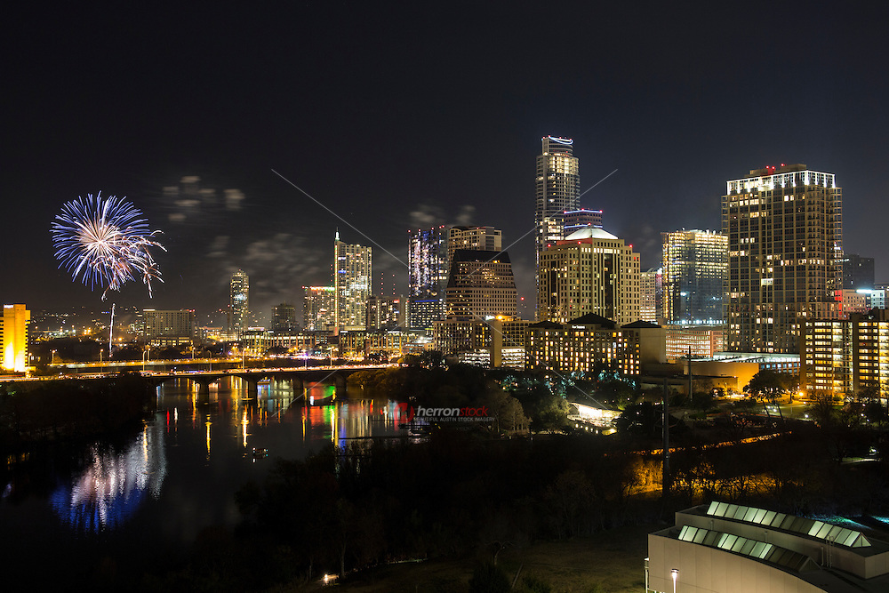 View from high-rise as Austin's colorful New Years Eve Fireworks display welcomes in the New Year in downtown Austin, Texas.