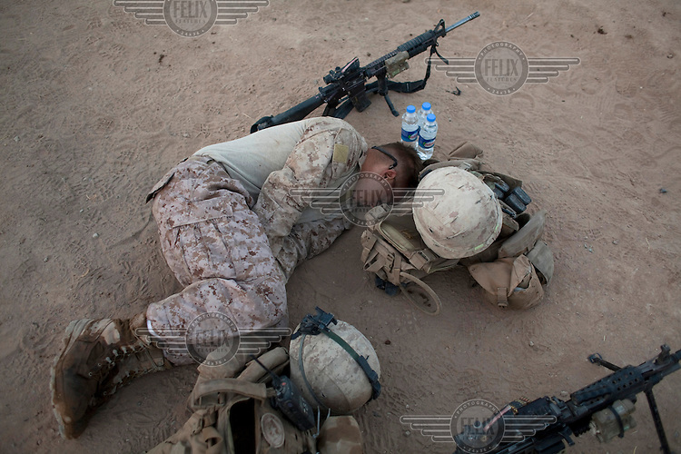 A US marine from 3-6, Lima Company rests before a dawn patrol at COP (Combat Outpost) Coutu in northern Marja.