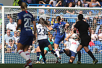A shot from Chelsea Women's Maren Mjelde is blocked by a Tottenham Hotspur defender during Chelsea Women vs Tottenham Hotspur Women, Barclays FA Women's Super League Football at Stamford Bridge on 8th September 2019