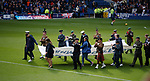 14.09.2019 Rangers v Livingston: Players, staff and armed forces personnel on the pitch at half time