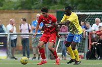 Ruel Sotiriou of Leyton Orient and Christian Adu-Gyamfi of Harlow Town during Harlow Town vs Leyton Orient, Friendly Match Football at The Harlow Arena on 6th July 2019