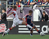 New England Revolution midfielder Kelyn Rowe (11) passes the ball as DC United defender Perry Kitchen (23) defends. In a Major League Soccer (MLS) match, DC United defeated the New England Revolution, 2-1, at Gillette Stadium on April 14, 2012.