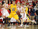 VERMILLION, SD - FEBRUARY 9: Chad White #25 from South Dakota State defends against Louie Krogman #4 from the University of South Dakota in the first half of their game Thursday night at the DaktaDome in Vermillion, SD. (Photo by Dave Eggen/Inertia)
