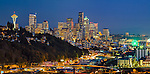 Seattle, Washington<br /> Panoramic night view of the city skyline and hillside homes of the Queen Ann neighborhood