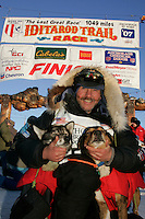 Wednesday March 14, 2007   ----   Norwegian Robert Sorlie poses with his two lead dogs after his arrival in Nome to take a 13th place finish.