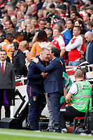 Arsenal manager, Unai Emery greets Aston Villa manager, Dean Smith during the Premier League match between Arsenal and Aston Villa at the Emirates Stadium, London, England on 22 September 2019. Photo by Carlton Myrie / PRiME Media Images.