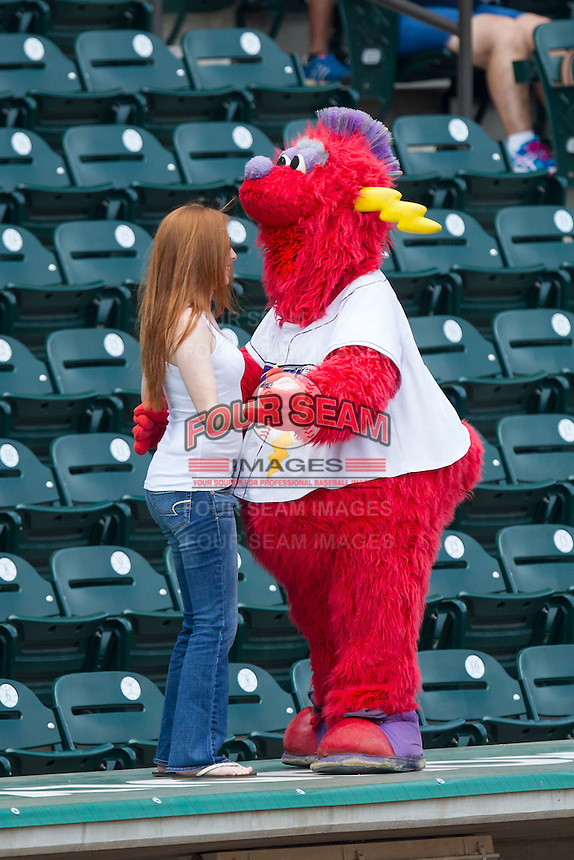 """Winston-Salem Dash mascot """"Bolt"""" dances with a young fan between innings of the game against the Frederick Keys at BB&T Ballpark on July 30, 2014 in Winston-Salem, North Carolina.  The Dash defeated the Keys 12-2.   (Brian Westerholt/Four Seam Images)"""