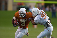 01 APRIL 2006: University of Texas running back Chris Ogbonnaya, left, tries to break a tackle by corner back Aaron Ross, right, at Darrell K. Royal Memorial Stadium during the Longhorns annual spring Orange vs White Scrimmage.