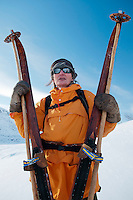 Saltoluokta Mountain Station, Jokkmokk, Lapland, Sweden, March 2013. Arctic survival training and winter bushcraft  in the frigid mountains of the Stora Sjofallet National Park and Sarek National Park with mountain guide Claes Jorgen Pohl.  Dressed in an orange 1980's anorak, Sami native Rolf Rimpi joins our tour on traditional wooden skis and poles. Photo by Frits Meyst/Adventure4ever.com