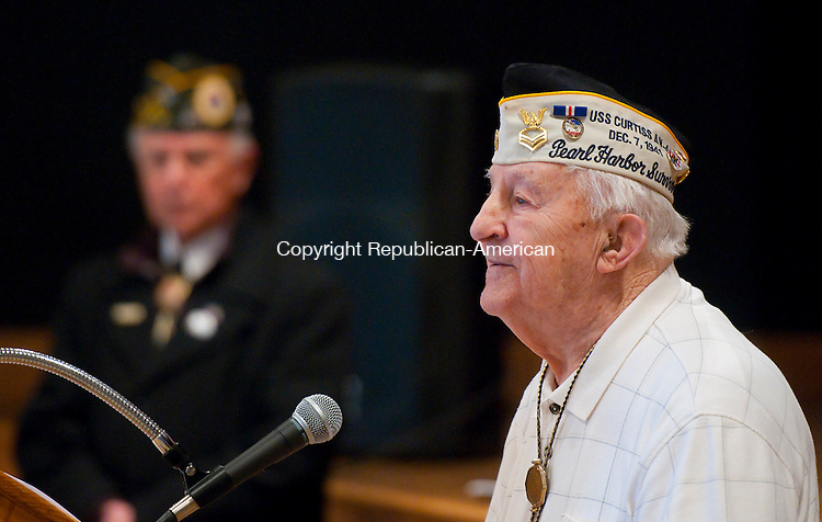 TORRINGTON, CT-120714JS09- Pearl Harbor survivor Isadore Tadiello, 93, of Canaan, talks about his experiences on December 7, 1941 while serving on the USS Curtiss (AV-4), a seaplane tender of the United State Navy, during the Pearl Harbor Day Observance Sunday at Coe Park in Torrington. The event was hosted by the Torrington Veterans Support Committee. <br /> Jim Shannon Republican-American