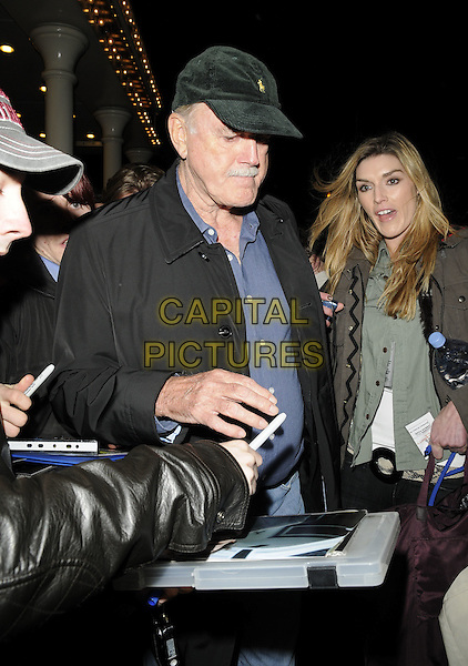 JOHN CLEESE .at the 24 Hour Plays Celebrity Gala, The Old Vic theatre, The Cut, London, England, UK, November 21st 2010..half length green cap hat blue shirt black jacket .CAP/CAN.©Can Nguyen/Capital Pictures.