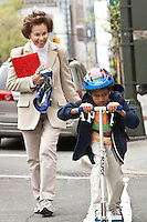 Marilyn Berger (R), widow of Don Hewitt, tries to catch up with Danny Hodes, the 8 year-old Ethiopian she has taken in, on the way back from school in New York, NY, USA, 9 April 2010. Ms Berger met him in Addis Ababa while reporting there and helped him get surgery.