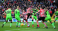 Lincoln City's John Akinde vies for possession with Forest Green Rovers' Paul Digby, left, Nathan McGinley and Lloyd James<br /> <br /> Photographer Andrew Vaughan/CameraSport<br /> <br /> The EFL Sky Bet League Two - Lincoln City v Forest Green Rovers - Saturday 3rd November 2018 - Sincil Bank - Lincoln<br /> <br /> World Copyright &copy; 2018 CameraSport. All rights reserved. 43 Linden Ave. Countesthorpe. Leicester. England. LE8 5PG - Tel: +44 (0) 116 277 4147 - admin@camerasport.com - www.camerasport.com