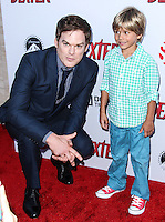 HOLLYWOOD, CA - JUNE 15: Michael C. Hall and Jadon Wells arrive at the premiere screening of Showtime's 'Dexter' Season 8 at Milk Studios on June 15, 2013 in Hollywood, California. (Photo by Celebrity Monitor)