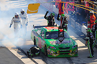 Sept. 21, 2008; Dover, DE, USA; Nascar Sprint Cup Series driver Kyle Busch sits on pit road as crew members look over his smoking car after engine problems during the Camping World RV 400 at Dover International Speedway. Mandatory Credit: Mark J. Rebilas-
