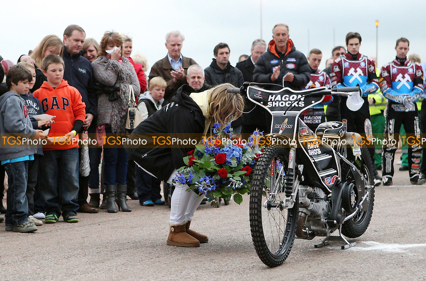 Lee Richardson's wife lays flowers at his bike - Lakeside Hammers vs Swindon Robins, Elite League Speedway at the Arena Essex Raceway, Pufleet - 18/05/12 - MANDATORY CREDIT: Rob Newell/TGSPHOTO - Self billing applies where appropriate - 0845 094 6026 - contact@tgsphoto.co.uk - NO UNPAID USE.