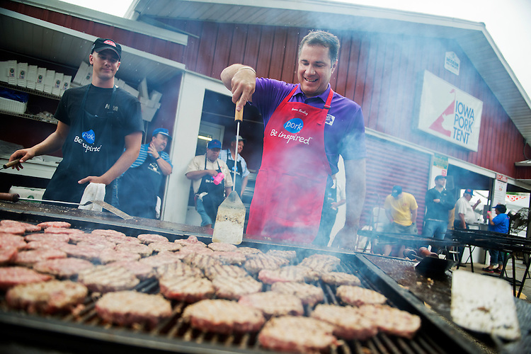 UNITED STATES - AUGUST 07: Senate candidate Rep. Bruce Braley, D-Iowa, helps out on the grill in the Pork Tent at the 2014 Iowa State Fair in Des Moines, Iowa, August 7, 2014. (Photo By Tom Williams/CQ Roll Call)