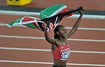 Faith Chepngetich KIPYEGON (KEN) celebrates with the Kenyan flag following her win in the womens 1500m final. IAAF world athletics championships. London Olympic stadium. Queen Elizabeth Olympic park. Stratford. London. UK. 07/08/2017. ~ MANDATORY CREDIT Garry Bowden/SIPPA - NO UNAUTHORISED USE - +44 7837 394578