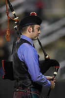 "A bagpipe player plays ""God Bless America"" during the 7th inning stretch of the South Atlantic League game between the Rome Braves and the Kannapolis Intimidators at Kannapolis Intimidators Stadium on April 4, 2019 in Kannapolis, North Carolina.  The Braves defeated the Intimidators 9-1. (Brian Westerholt/Four Seam Images)"