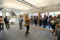 NWA Democrat-Gazette/ANDY SHUPE<br /> Wendy Riggs (center), vice president of operations for the center, speaks Tuesday, Sept. 22, 2015, during a tour of the new administrative offices being constructed as part of Fayetteville's $12.3 million municipal parking deck project. The arts center contributed more than $2.2 million to the project which will house administrative staff and include additional back-of-house space for the performing arts center. Visit nwadg.com/photos to see more photographs from the tour.