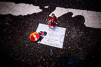 "Oslo, Norway, 23.07.2011. A note in is placed on the ground with flowers and candles. The note reads: ""For the King and the Nation. We will not be pressured"". Oslo awakes to shocking messages of the total bodycount after yesterdays massacre. A total of 91 persons were killed in the massacre in Utøya right outside Oslo. Seven of those died when a car bomb was detonated outside the main government biuilding in the heart of Oslo, friday 22. of July. Foto: Christopher Olssøn."