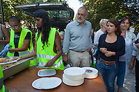 Italy. Lombardy Region. Como. Three swiss politicians from the Socialist party: (Left to right) Carlo Sommaruga, Mattea Meyer, Marina Carobbio Guscetti. They stand at the food distribution provided by the swiss NGO Firdaus for homeless african migrants living in the park below the San Giovanni railway station. A non-governmental organization (NGO) is a not-for-profit organization that is independent from states and international governmental organisation. 12.08.2016 © 2016 Didier Ruef