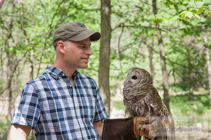 Chris Soucy, holding a Barred Owl, The Raptor Trust, New Jersey