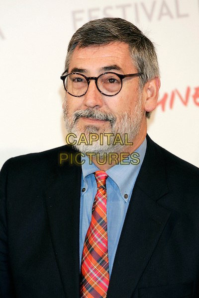 JOHN LANDIS.Photocall for 'Burke & Hare' during the Rome International Film Festival, Rome, Italy..October 29th, 2010.headshot portrait black blue red plaid tartan tie glasses beard facial hair.CAP/PE.©Peter Eden/Capital Pictures.