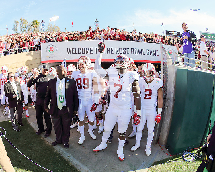 Pasadena, CA - January 1, 2016: Stanford defeats Iowa 45-16 in the 102nd Rose Bowl Game.  Team and fans watch a B2 bomber (upper right)  fly overhead during the National Anthem.